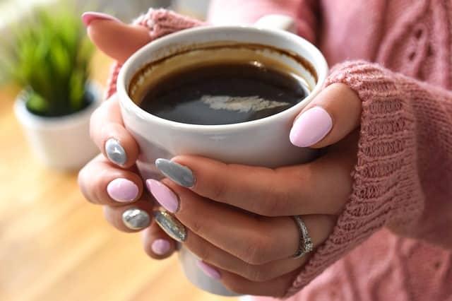 Bild Kaffee in der Hand